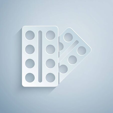 Paper cut Pills in blister pack icon isolated on grey background. Medical drug package for tablet, vitamin, antibiotic, aspirin. Paper art style.