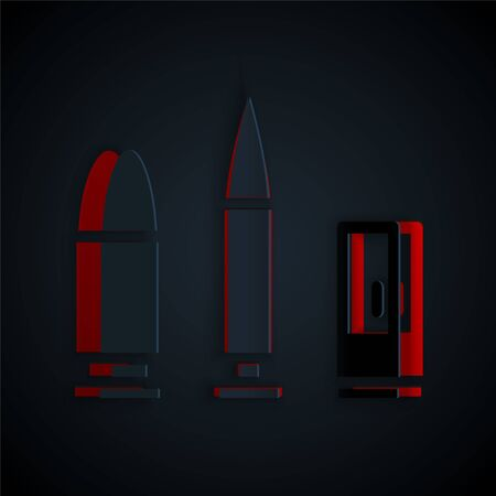 Paper cut Bullet and cartridge icon isolated on black background. Paper art style. Vector.
