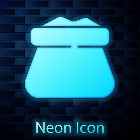 Glowing neon Full sack icon isolated on brick wall background. Vector.