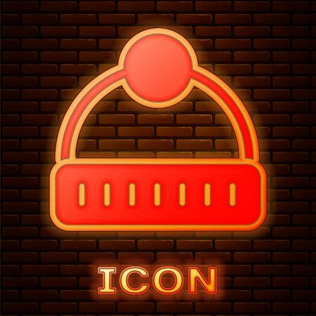 Glowing neon Winter hat icon isolated on brick wall background. Vector.
