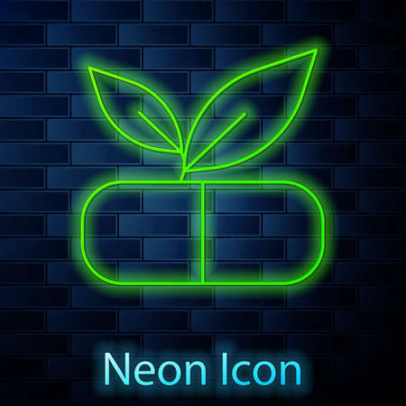 Glowing neon line Medical pill with plant icon isolated on brick wall background. Herbal pill.  Vector.