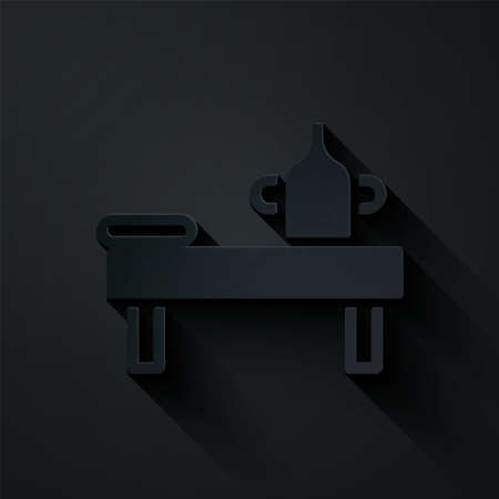Paper cut Massage table with oil icon isolated on black background. Paper art style. Vector. Çizim