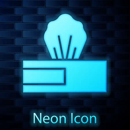 Glowing neon Wet wipe pack icon isolated on brick wall background. Vector..