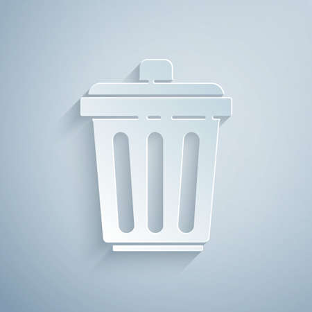 Paper cut Trash can icon isolated on grey background. Garbage bin sign. Recycle basket icon. Office trash icon. Paper art style. Vector Illustration.