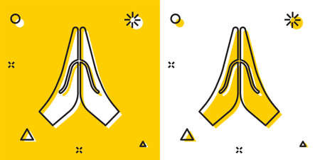 Black Hands in praying position icon isolated on yellow and white background. Prayer to god with faith and hope. Random dynamic shapes. Vector Illustration.