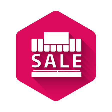 White Shopping building or market store icon isolated with long shadow. Supermarket sale concept. Pink hexagon button. Vector Illustration.