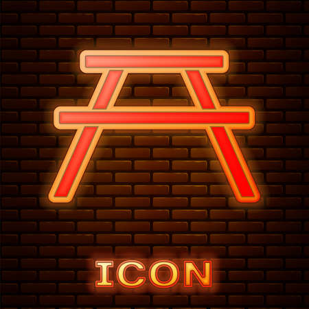 Glowing neon Picnic table with benches on either side of the table icon isolated on brick wall background. Vector Illustration.