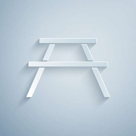 Paper cut Picnic table with benches on either side of the table icon isolated on grey background. Paper art style. Vector Illustration