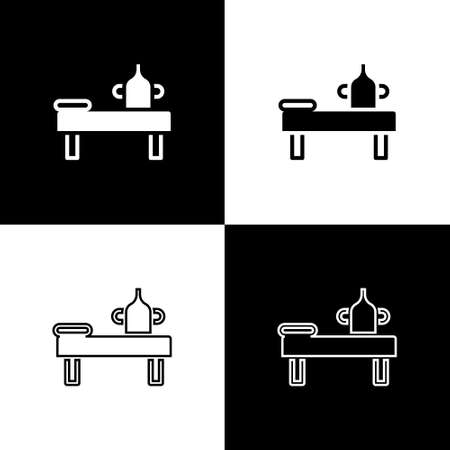 Set Massage table with oil icon isolated on black and white background. Vector