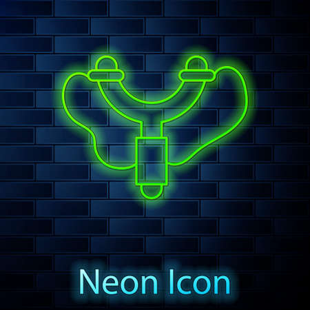 Glowing neon line Slingshot icon isolated on brick wall background. Vector