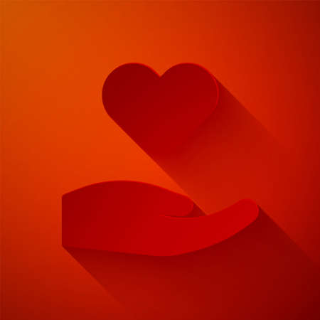 Paper cut Heart in hand icon isolated on red background. Hand giving love symbol. Valentines day symbol. Paper art style. Vector Stock Illustratie