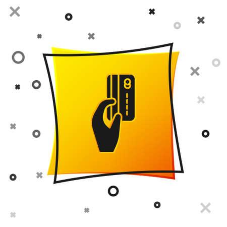 Black Human hand holding with credit card icon isolated on white background. Online payment. Pay by card. Financial operations. Yellow square button. Vector Illustration
