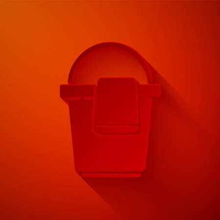 Paper cut Bucket with rag icon isolated on red background. Cleaning service concept. Paper art style. Vector Illustration