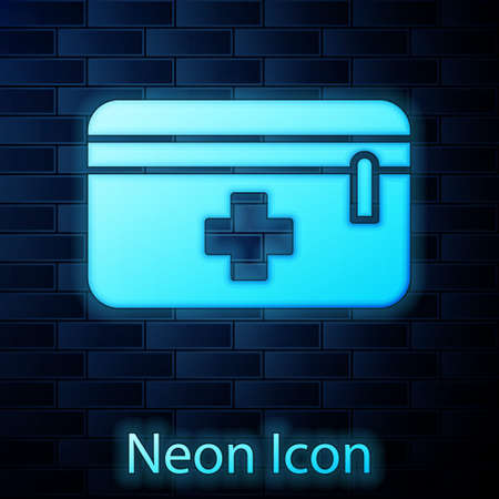 Glowing neon First aid kit icon isolated on brick wall background. Medical box with cross. Medical equipment for emergency. Healthcare concept. Vector Illustration