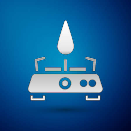 Silver Camping gas stove icon isolated on blue background. Portable gas burner. Hiking, camping equipment. Vector