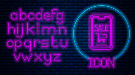 Glowing neon Mobile phone and shopping cart icon isolated on brick wall background. Online buying symbol. Supermarket basket symbol. Neon light alphabet. Vector Illustration.