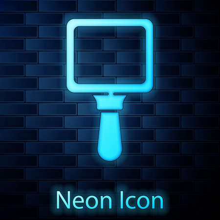 Glowing neon Hand mirror icon isolated on brick wall background. Vector Illustration