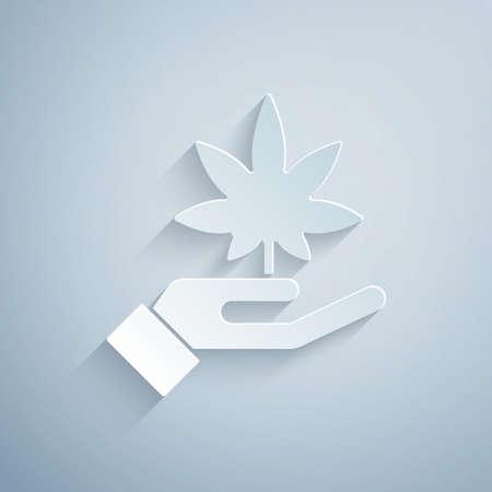 Paper cut Medical marijuana or cannabis leaf icon isolated on grey background. Hemp symbol. Paper art style. Vector Illustration