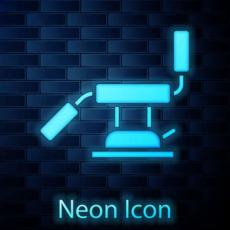 Glowing neon Medical dental chair icon isolated on brick wall background. Dentist chair. Vector Illustration Ilustração