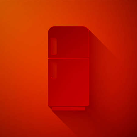 Paper cut Refrigerator icon isolated on red background. Fridge freezer refrigerator. Household tech and appliances. Paper art style. Vector