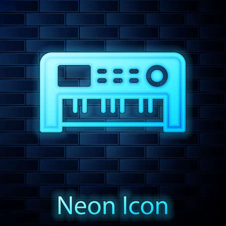 Glowing neon Music synthesizer icon isolated on brick wall background. Electronic piano. Vector 向量圖像
