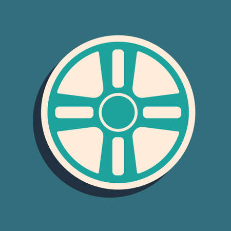 Green Alloy wheel for a car icon isolated on green background. Long shadow style. Vector
