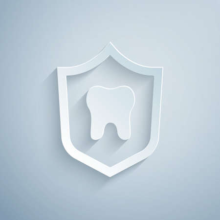 Paper cut Dental protection icon isolated on grey background. Tooth on shield icon. Paper art style. Vector
