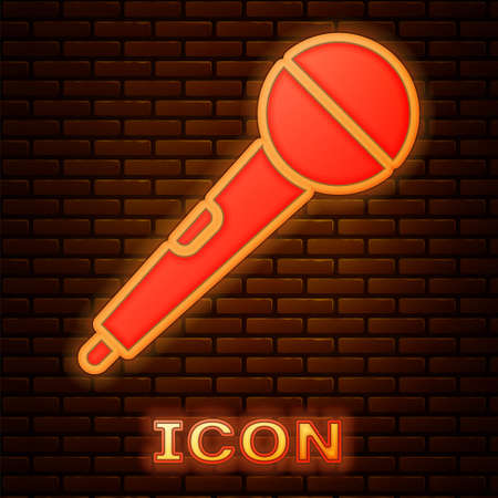 Glowing neon Microphone icon isolated on brick wall background. On air radio mic microphone. Speaker sign. Vector