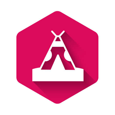 White Traditional indian teepee or wigwam icon isolated with long shadow. Indian tent. Pink hexagon button. Vector