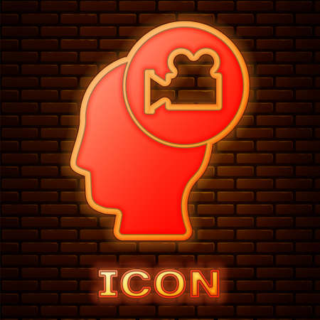 Glowing neon Head with camera icon isolated on brick wall background. Video camera. Movie sign. Film projector. Vector
