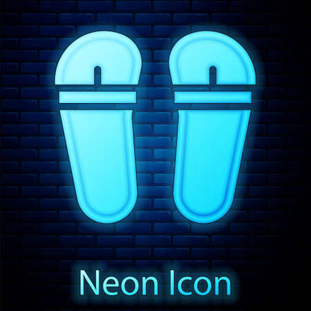 Glowing neon Flip flops icon isolated on brick wall background. Beach slippers sign. Vector