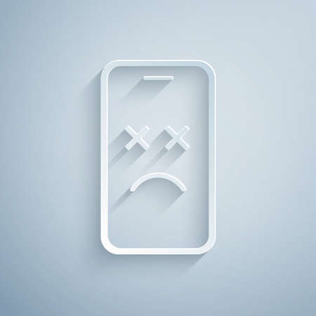 Paper cut Dead mobile icon isolated on grey background. Deceased digital device emoji symbol. Corpse smartphone showing facial emotion. Paper art style. Vector