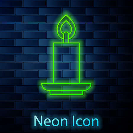 Glowing neon line Burning candle icon isolated on brick wall background. Cylindrical candle stick with burning flame. Vector