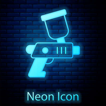 Glowing neon Paint spray gun icon isolated on brick wall background. Vector