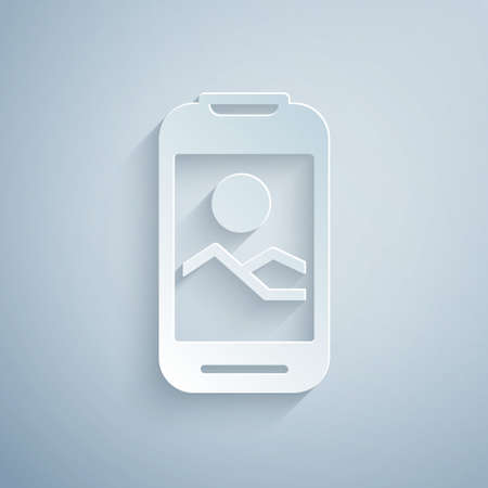 Paper cut Smartphone, mobile phone icon isolated on grey background. Paper art style. Vector Vettoriali