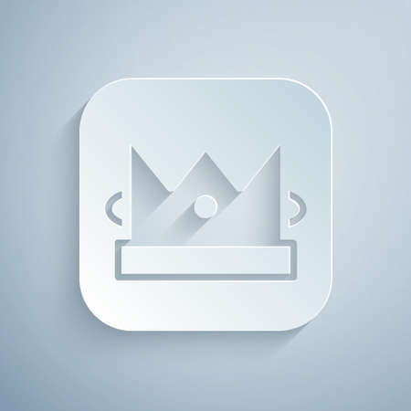 Paper cut King playing card icon isolated on grey background. Casino gambling. Paper art style. Vector