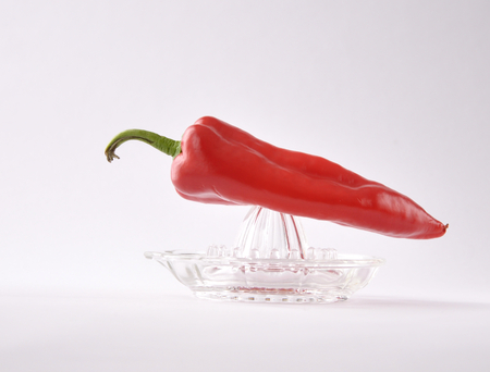 juicer: glass juicer with red pepper