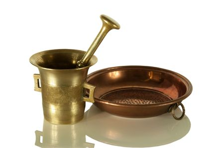 Old bronze mortar with pestle and copper sieve isolated on white Stock Photo - 6209981