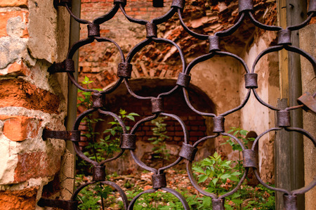 Part of the old forged bars on the window of the church.
