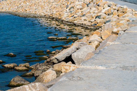backwater: Some marine backwater and stone breakwater bright day. Stock Photo