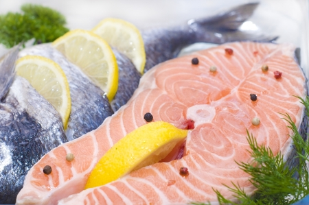 red fish - trout with lemon and spices photo