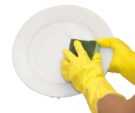 hands in yellow gloves wash  white plate Stock Photo - 16500537