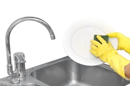 Hands in household gloves washing plate Stock Photo - 16500535