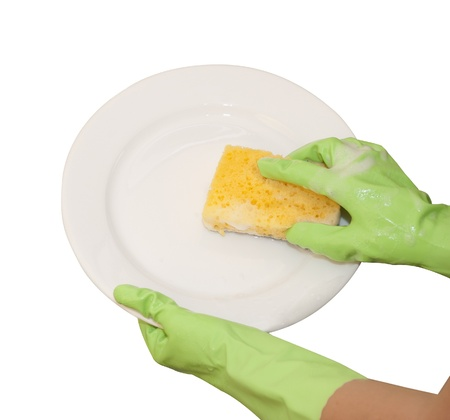 hands in green gloves wash  white plate Stock Photo - 16500526