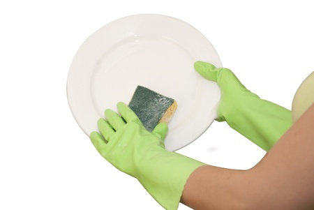 hands in green gloves wash  white plate photo
