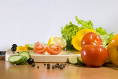 slices of red tomato surrounded vegetables Stock Photo - 16500547