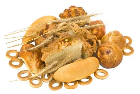 baked  goods: many golden baked goods on white