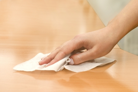 hand with wet wipe cleaning table Stock Photo - 16537425