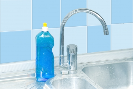blue dish washer on kitchen with cleaner, tap, tile water drops Stock Photo - 16563378