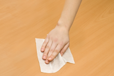 hand with white wet wipe kithchen cleaning Stock Photo
